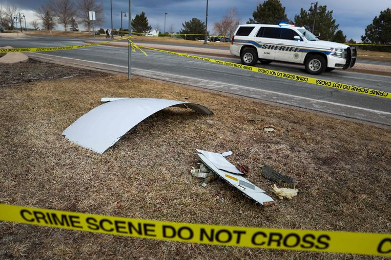 Brokstukken op de grond in Broomfield, Colorado. Beeld AFP