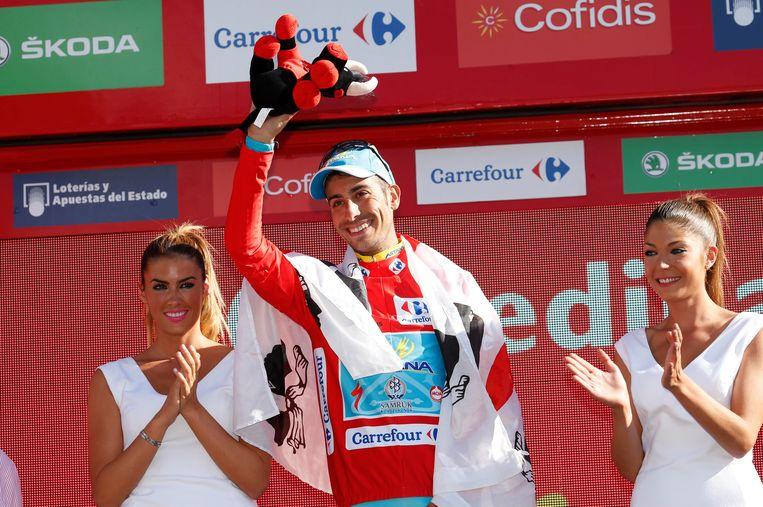 20150912 - CERCEDILLA, SPAIN: Italian Fabio Aru of Astana Pro Team celebrates on the podium stage 20 of the 70th edition of the 'La Vuelta' cycling race, 175,8km from San Lorenzo de El Escorial to Cercedilla, Spain, Saturday 12 September 2015. BELGA PHOTO YUZURU SUNADA Beeld null