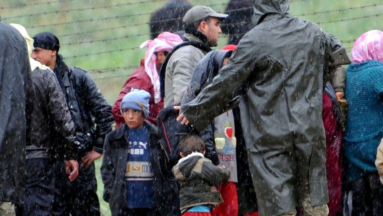 Syrische vluchtelingen komen aan bij de Turkse grens. Beeld null