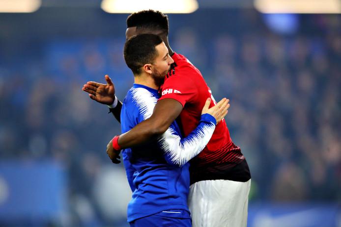 Paul Pogba en Eden Hazard wensen elkaar succes voor de wedstrijd.