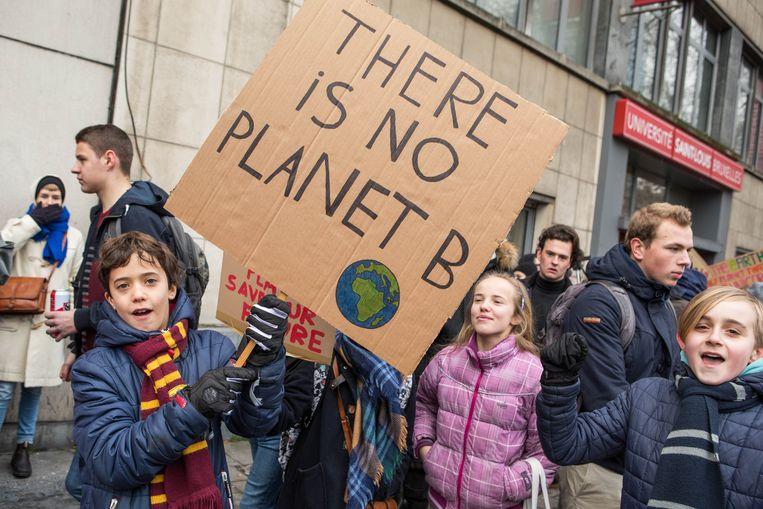 Belgische jongeren die demonstreren voor een schonere wereld. Beeld BELGA
