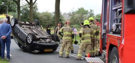 Auto slaat over de kop bij Ede, bestuurder gewond