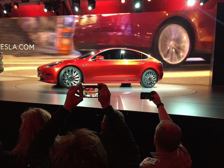 Tesla komt in handen van Apple, volgens Saxo Bank, in zijn jaarlijkse voorspellingen voor het komende jaar. Beeld AP