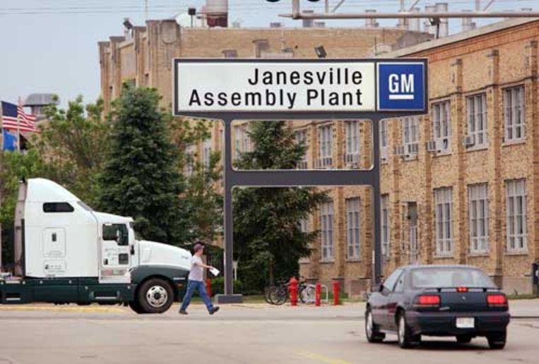 Toegangspoort van de Janesville assemblagefabriek van General Motors. (AFP) Beeld