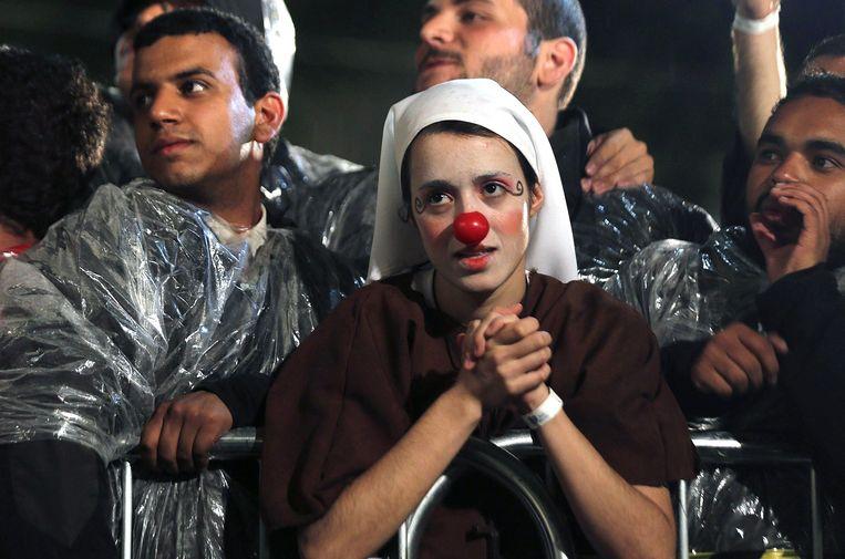 Een non luistert naar de paus bij een ziekenhuis voor drugsverslaafden, Brazilië, juli 2013. Beeld epa