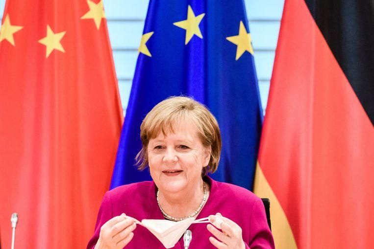 Angela Merkel bij een overleg met China. Beeld EPA