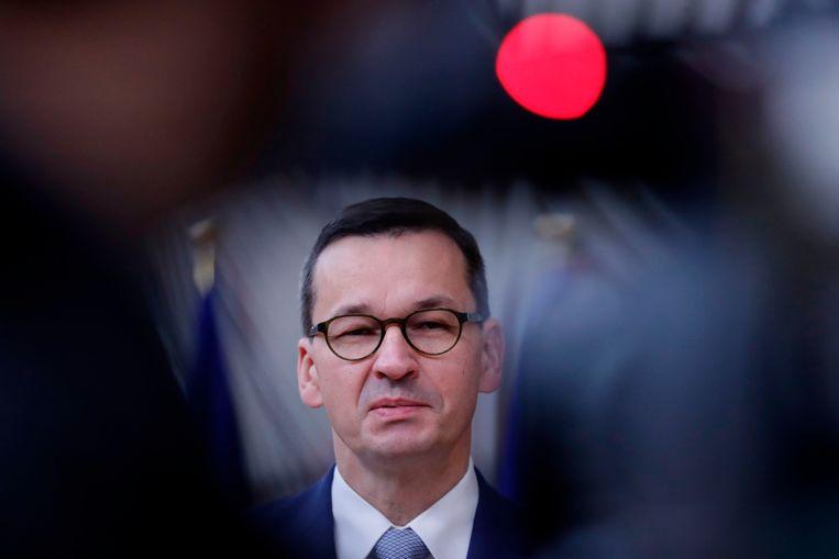 De Poolse premier Mateusz Morawiecki komt aan in Brussel voor de EU-top. Beeld AFP