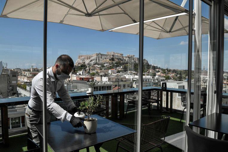 Het zomerseizoen in Griekenland: toeristen blijven weg.  Beeld AFP