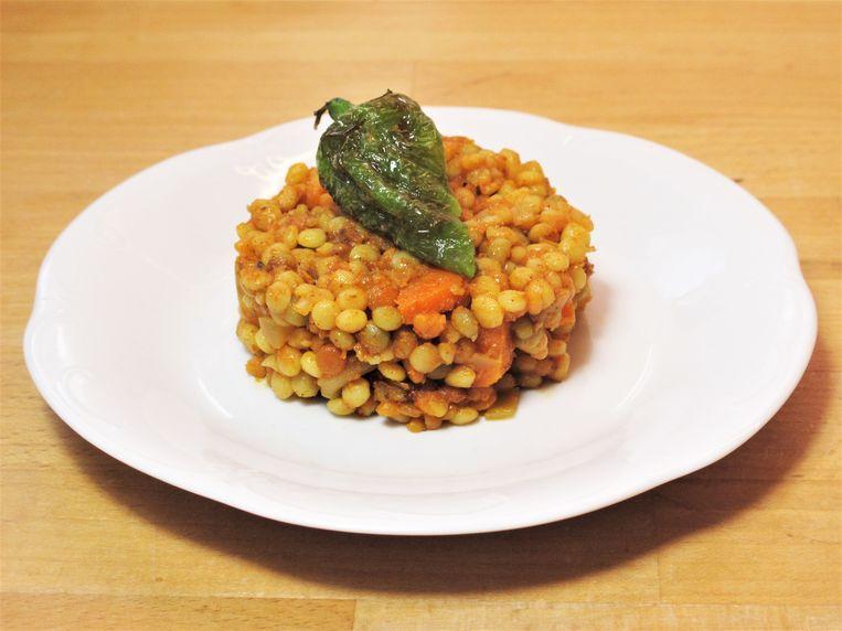 Marokkaanse berkouks  met wortel, aardappel en gefrituurde pepertjes Beeld Pay-Uun Hiu