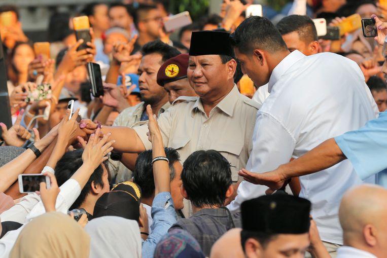 De Indonesische presidentskandidaat Prabowo Subianto claimde vandaag de overwinning in Jakarta, hoewel de eerste uitslagen anders uitwijzen. Beeld AP