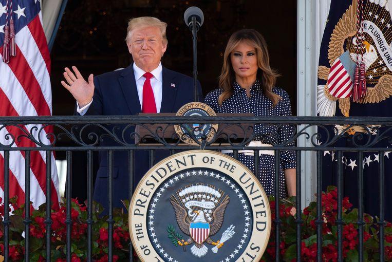 De Amerikaanse president Donald Trump en zijn vrouw Melania vrijdag in het Witte Huis. Beeld AFP