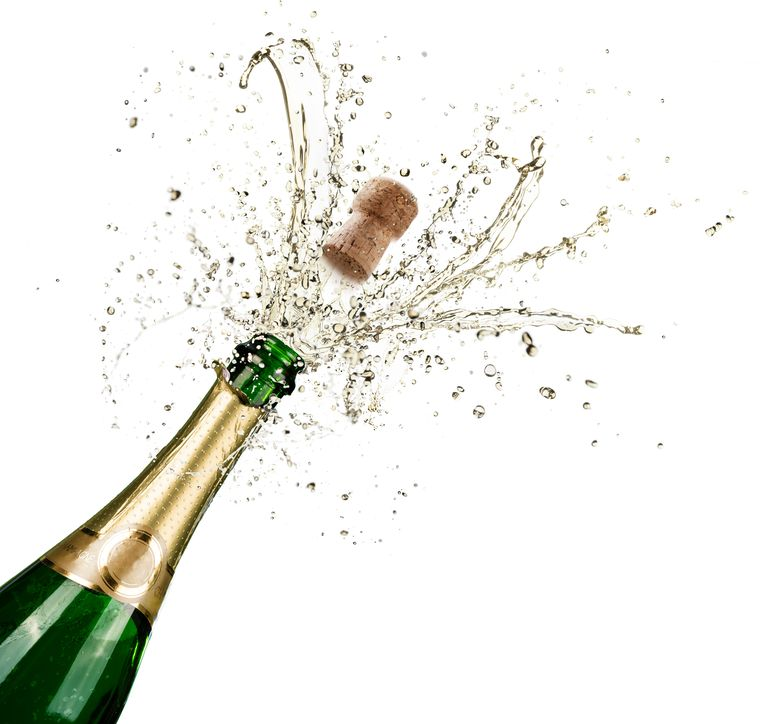 Bottle With Champagne Explosion On White