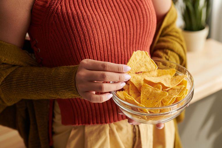 Hoe lang moet je sporten om één handje chips te verbranden? Beeld Getty Images