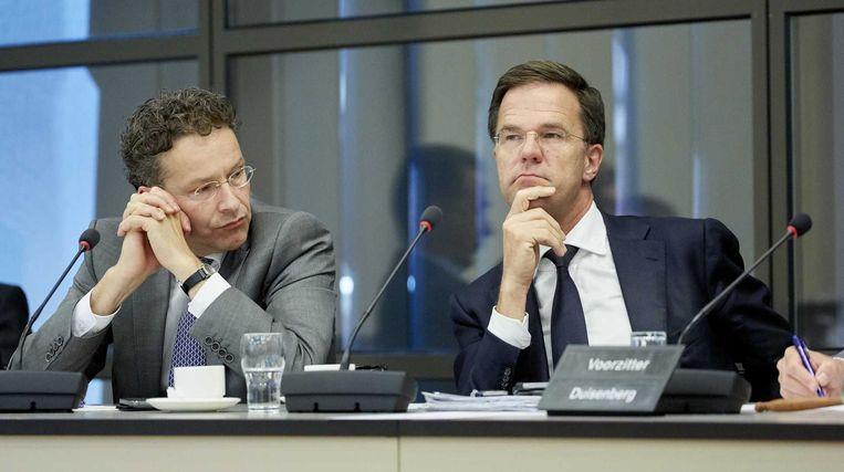 Jeroen Dijsselbloem en Mark Rutte tijdens het debat vanavond. Beeld ANP