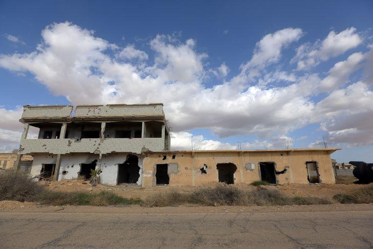 Een verwoest gebouw in Libië. Archieffoto. Beeld AFP