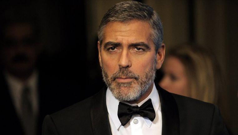 Clooney zei zondagavond dat de liedjes van deze optredens tegen betaling beschikbaar worden gemaakt via iTunes. Foto EPA Beeld