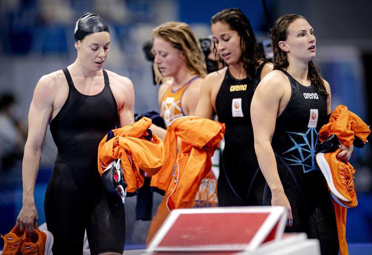 Femke Heemskerk, Kira Toussaint, Ranomi Kromowidjojo en Kim Busch in actie tijdens de 4x100 meter estafette zwemmen op de Olympische Spelen. Beeld ANP / Robin van Lonkhuijsen