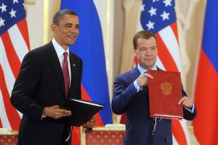 Barack Obama en Dmitry Medvedev bij een persconferentie in 2010, na het tekenen van kernwapenverdrag START II. Beeld EPA