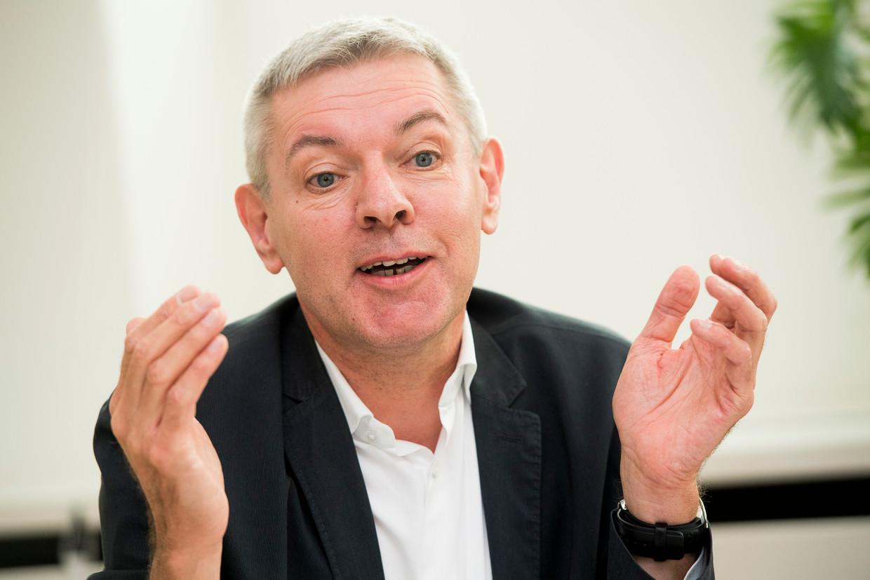 Professor Andre Decoster denkt dat de economische schok van de coronacrisis  best verteerbaar is. Beeld BELGA