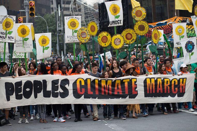 Een klimaatmars in New York in 2014. Beeld Photo News