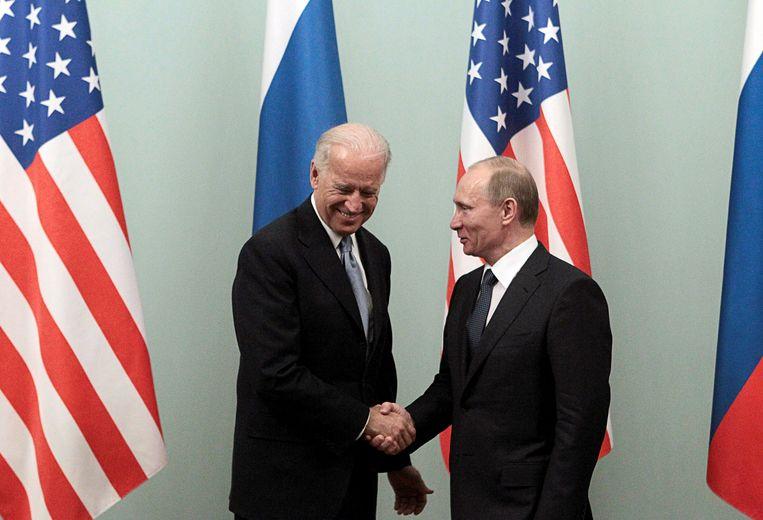 Biden en Poetin na een vergadering in 2011. Beeld REUTERS