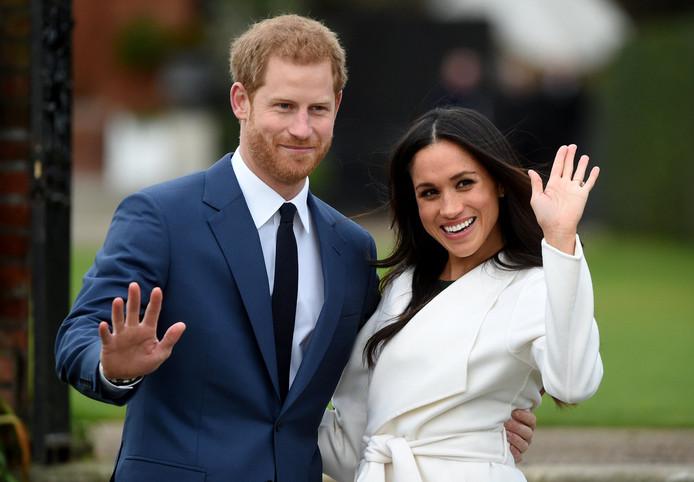 De Britse prins Harry met zijn verloofde Meghan Markle.