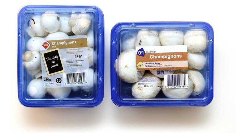 Bakjes champignons van Albert Heijn en C1000. Beeld anp