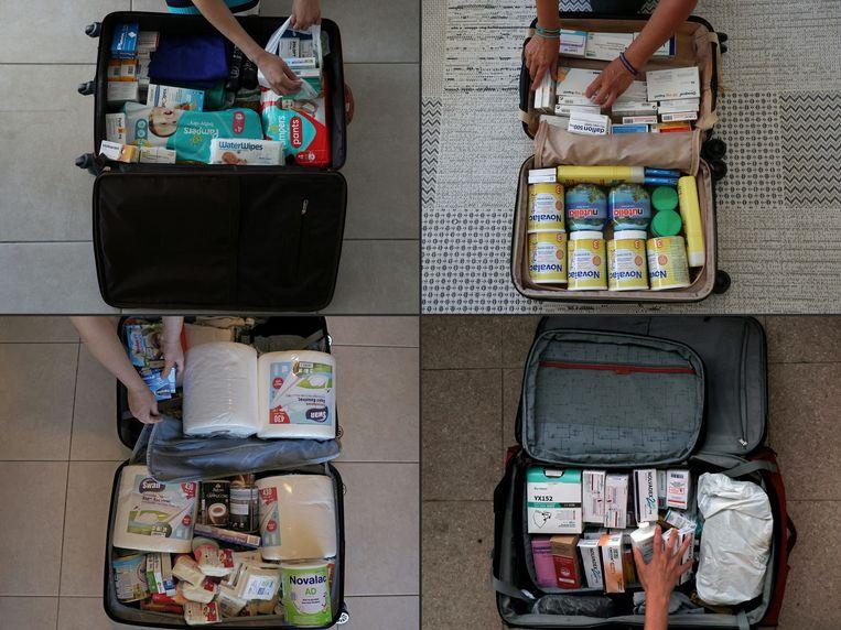 Dit zijn koffers van Libanese expats die op het punt staan te vertrekken uit Cyprus.De koffers zijn goeddeels gevuld met medicijnen en verzorgingsproducten. Daaraan bestaat een groot gebrek in Libanon, dat kampt met een ongekende financiële crisis. De helft van de bevolking leeft in armoede en apotheken en drogisterijen zijn door hun voorraden heen.  Beeld AFP