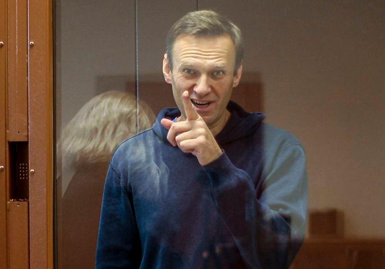 Aleksej Navalny afgelopen dinsdag tijdens een hoorzitting in een rechtbank in Moskou.  Beeld AP