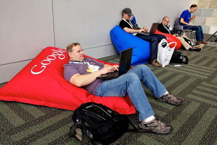 Programmeurs van Google tijdens een pauze op een conferentie in  San Francisco. Beeld Corbis via Getty Images