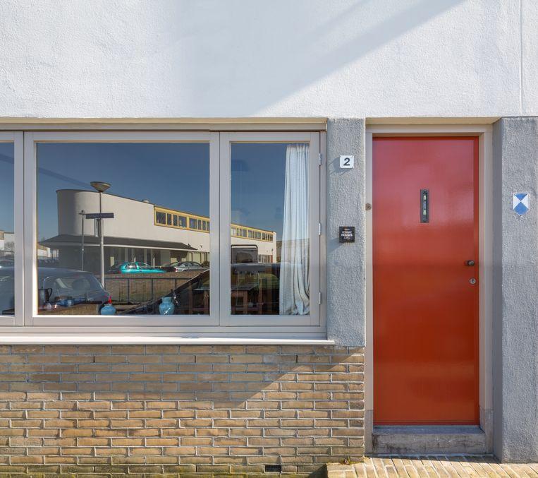 Vooraanzicht van een woning in De Kiefhoek in Rotterdam Beeld Ossip van Duivenbode