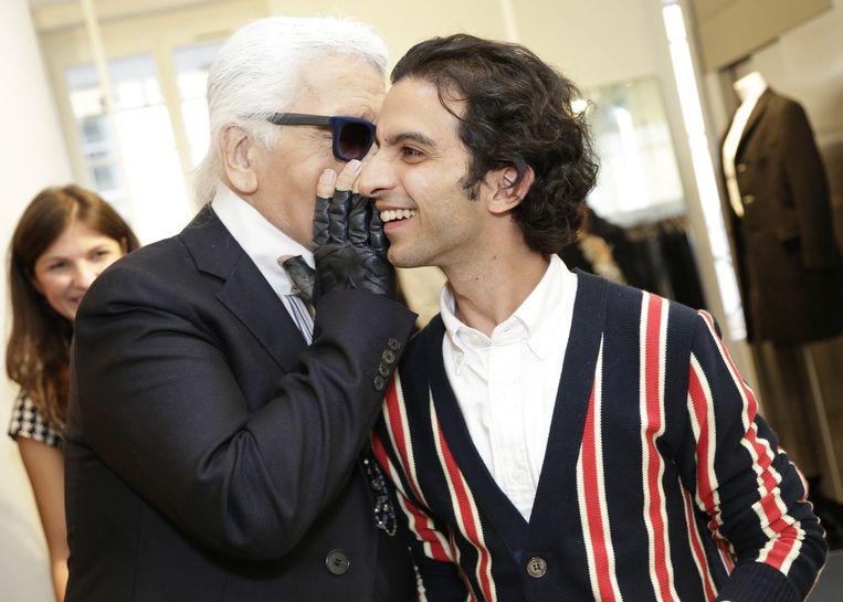 Imran Amed (met Karl Lagerfeld) 'Hij heeft vooral oog voor de zakelijke kant van mode. Dat is verfrissend.' Beeld Erin Baiano / HH