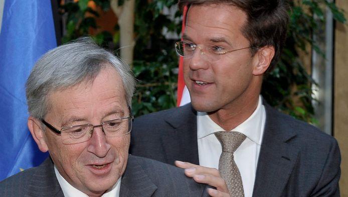 Rutte en Juncker tijdens een gezamenlijke persconferentie in 2010.