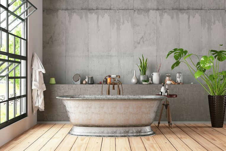 Bathtub in the loft interior Beeld Getty Images