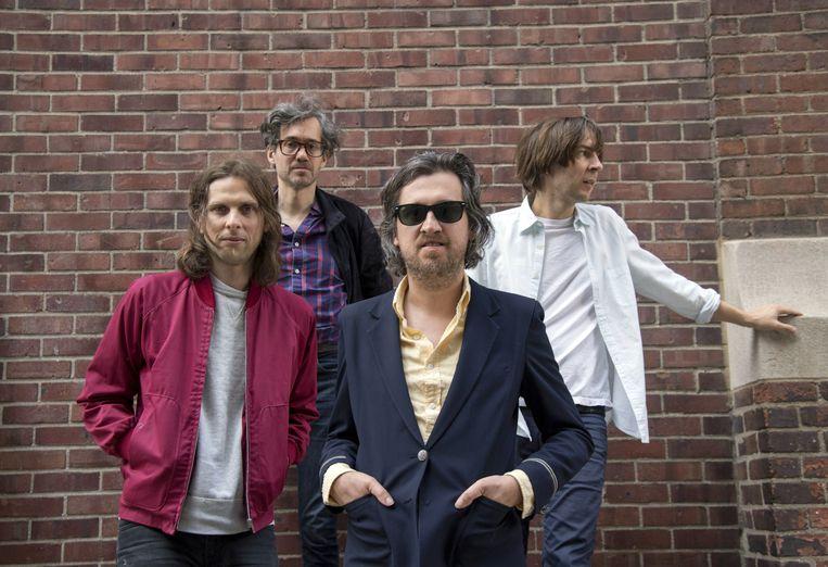 De Franse rockgroep Phoenix, met achteraan links Laurent Brancowitz. De gitarist tekent voor de Italiaanse touch op het nieuwe album 'Ti Amo'. Beeld AFP