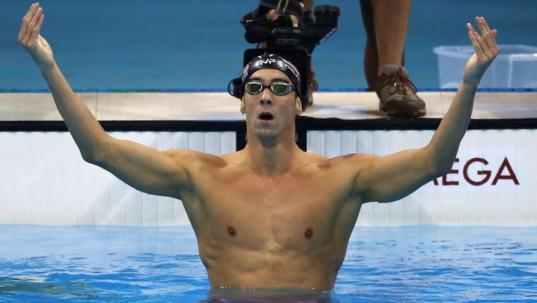 Michael Phelps na zijn zege op de 200 meter vlinder. Beeld getty