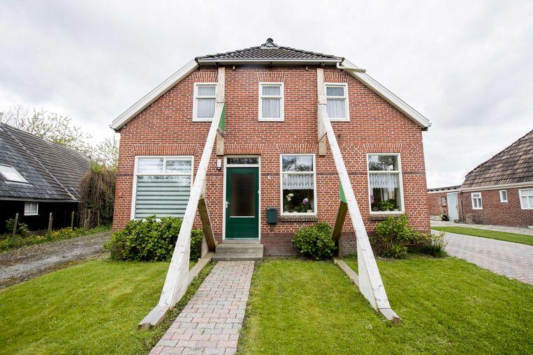 Een woning met schade door de herhaaldelijke aardbevingen in Groningen. Beeld ANP