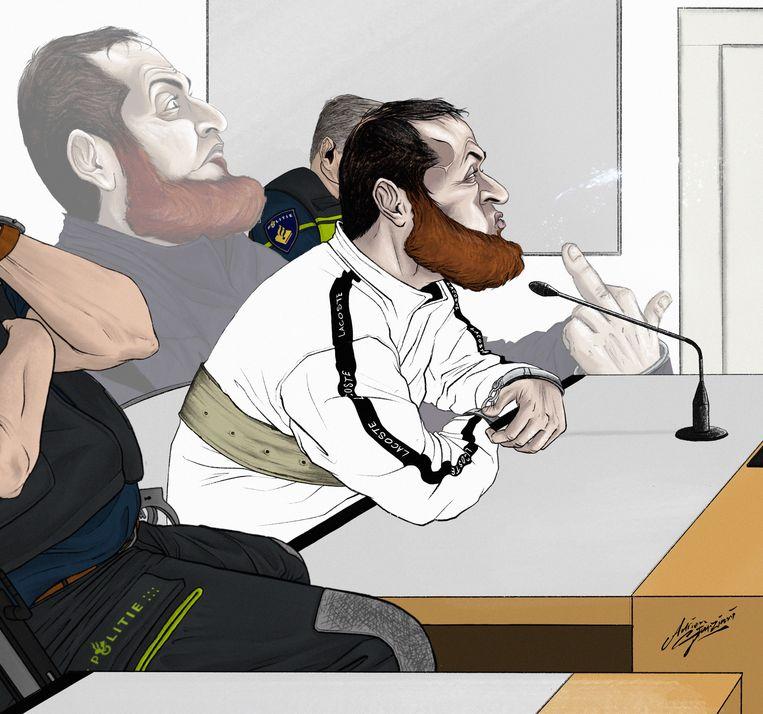 Gökmen T. in de rechtszaal, spugend naar de rechter. Beeld Adrien Stanziani