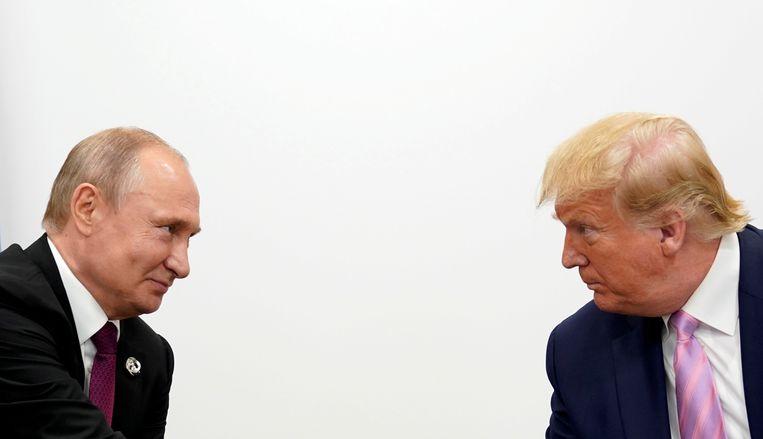 President Donald Trump en president Vladimir Poetin.  Beeld REUTERS