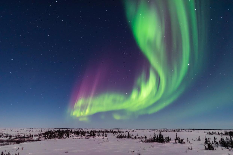 Behalve kompassen en gps, wordt ook het noorderlicht beïnvloed door het magnetisch veld van de aarde. Beeld Getty