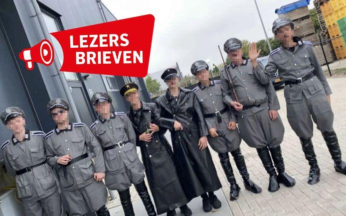 De burgemeester van Urk heeft de verkleedpartij van deze jonge mannen veroordeeld.