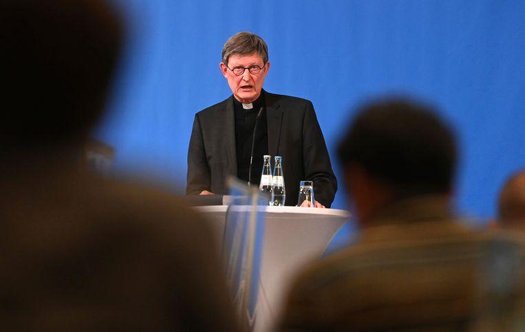 Rainer Maria Woelki op een persconferentie over het onderzoek in Keulen. Beeld AP