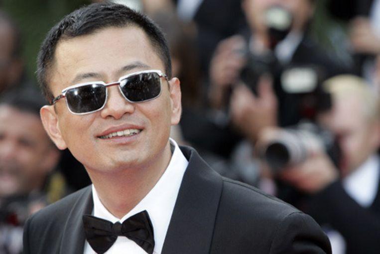 De Hongkongse filmmaker Wong Kar-wai arriveert bij het Festival Paleis in Cannes voor de opening van de 60ste editie van het Cannes Film Festival. Zijn film Blueberry Nights, met in de hoofrol de Amerikaanse zangeres Norah Jones, is de openingsfilm. (AFP) Beeld