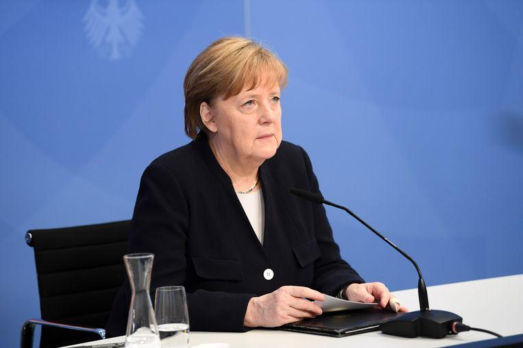 Merkel hield haar toespraak woensdag via een live-verbinding vanuit Berlijn. Beeld EPA