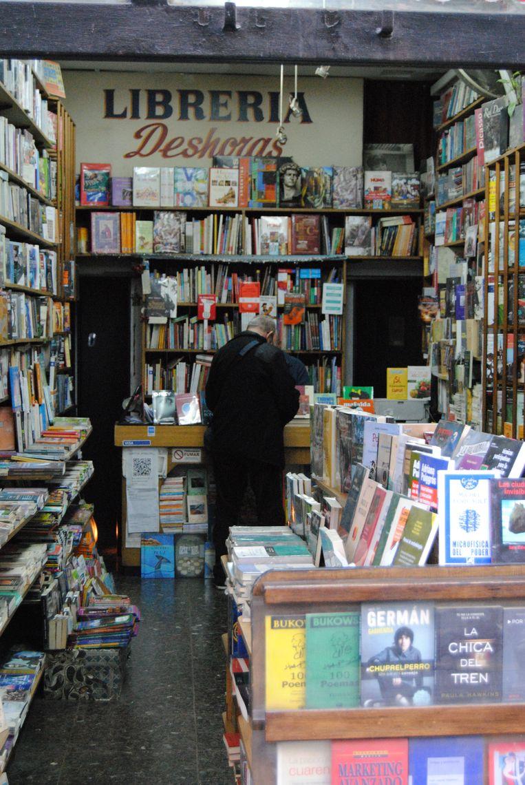 Boeken, boeken, en nog eens boeken. Beeld Ewoud Ceulemans