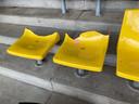 Vernielde stoeltjes op de tribune van SV Colmschate.