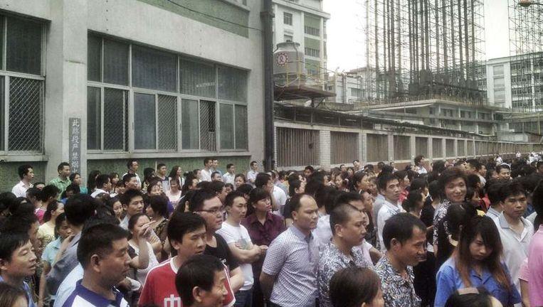 Stakingen bij sportschoenenmaker Yue Yuen. Beeld reuters