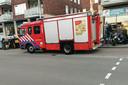 Brandweer bij het complex.
