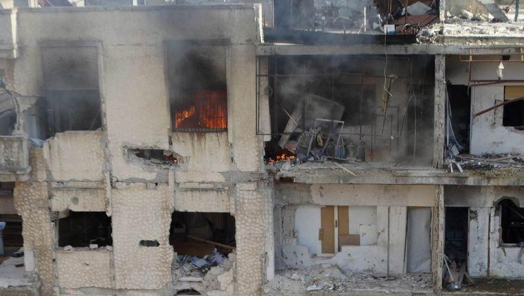 Verwoeste gebouwen in de Syrische stad Homs. Beeld REUTERS