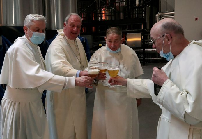 Prior Johan Goossens, abbot Erik De Sutter, father Stefaan Verstraeten and father Ton Smith toast after blessing beer tanks at the Belgian Abbey of Grimbergen